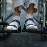 iStock_000003478127XSmall old woman feet in wheelchair