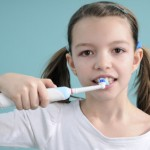 iStock_000015797755XSmall young girl with powered electric toothbrush