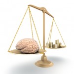 iStock_000016855583XSmall weighing scales with brain and money