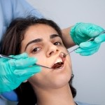 A woman having a dental examination.