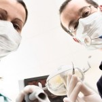 shutterstock_2092494 Dentist and assistant are examining you the patient