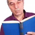 shutterstock_43211983 old man reading book