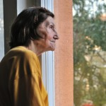 shutterstock_45554728 sad lonely old woman looking out window