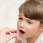 shutterstock_78209539- girl pill