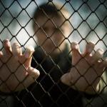 man at fence