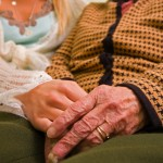 shutterstock_25879933 old woman social worker holding hands