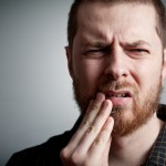 shutterstock_73929085 dental pain bearded man