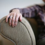 shutterstock_12718681 lonely old woman arm on sofa