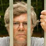 shutterstock_55935814 prison man behind bars