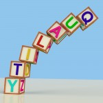 Wooden bricks spelling quality and toppling over