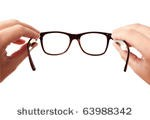 stock-photo-closeup-image-two-hands-holding-black-classic-glasses-while-putting-your-eye-wear-on-isolated-on-63988342