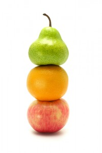 pear, organe and apple stacked on top of each other
