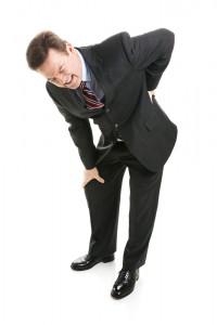 office worker holding back grimacing