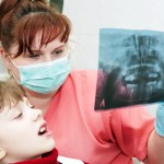 shutterstock_54042145 - Child, dentists & X-ray