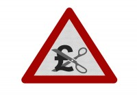 Road sign with a pair of scissors cutting through a pound sign