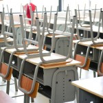 Classroom chairs stacked on tables