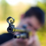 Young man with shot gun