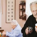 Senior couple taking medication