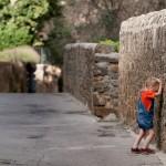 Upset girl facing the wall