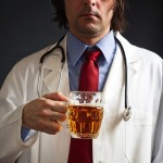 Doctor with pint of beer