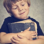Boy hugging a book