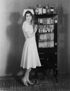 Vintage picture of nurse and medicine cabinet