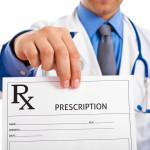 Doctor holding up a prescription form