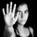 Teenage girl holding up her hand