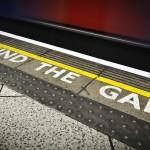 Underground station sign saying mind the gap