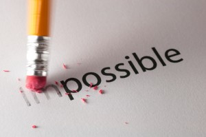 The word impossible, with the im being rubbed out