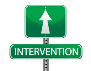 Sign with an arrow and the word intervention