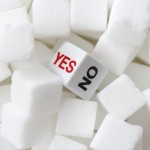 Sugar lumps with a dice in the middle with the options of yes or no