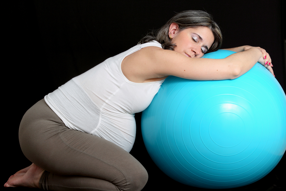 Exercise balls are a popular training aid and also a soft place to grab a few minutes sneaky shut-eye.