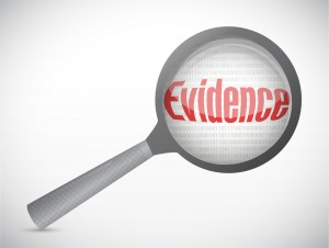 Magnifying glass over the word evidence
