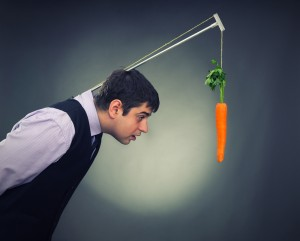 Man with a carrot dangling in front of him