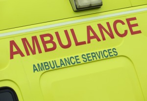 Close up of an ambulance showing the words ambulance services