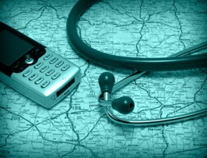 Mobile phone and stethoscope lying on a map