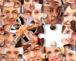Lots of jigsaw puzzle pieces with peoples' faces on them
