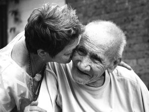 A family carer with an elderly man