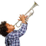 Young,Artist,Proudly,Plays,The,Trumpet.,Boy,Improvises,On,The
