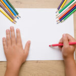 Little,Girl's,Hand,Painting,On,The,White,Paper,With,Pink