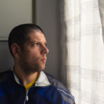 Headshot,Of,A,Young,Man,Looking,Sad,At,The,Window